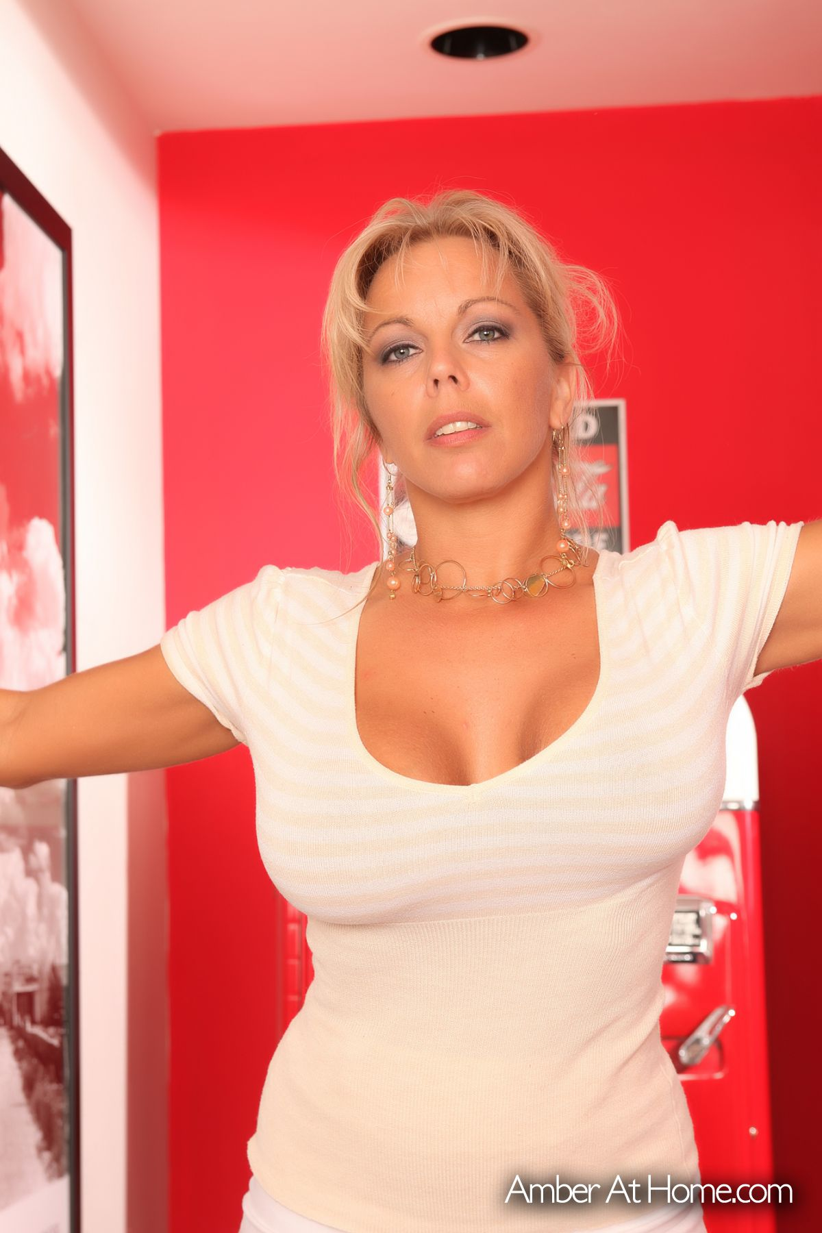 Cute and busty MILF Amber Lynn Bach sheds her dress to bare her huge boobs  1164916